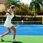 people playing tennis in tropics